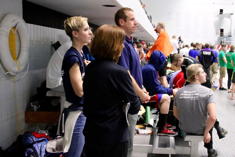 PHS Swim coaches focus in the moments before the competition begins