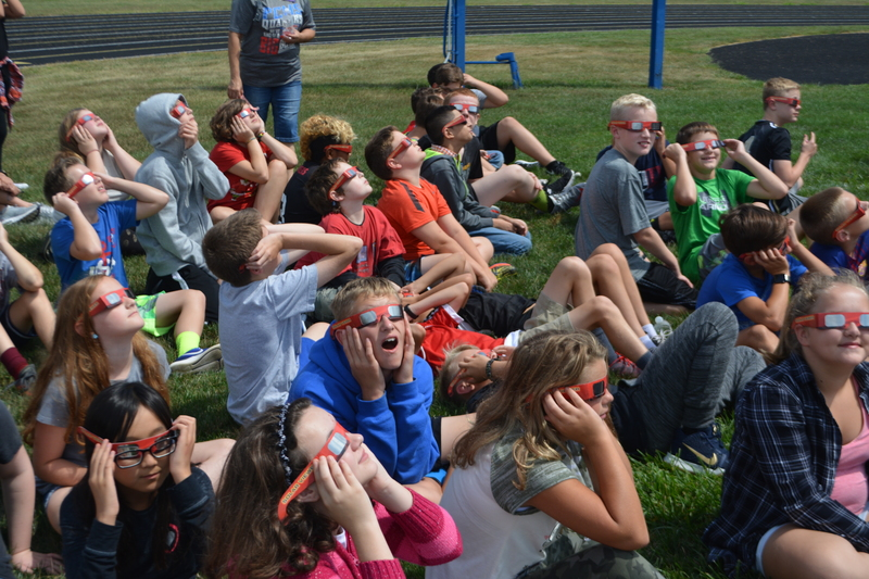 PCMS students react to seeing the eclipse through their special glasses.